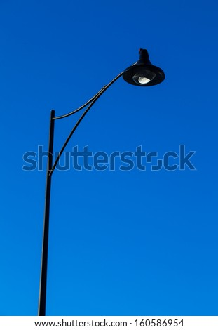 street lamp post with blue sky back ground - stock photo