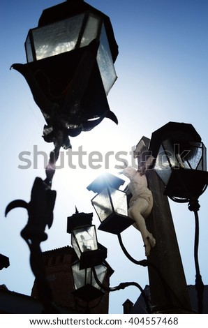 Street lamp with Jesus on Majorca - stock photo