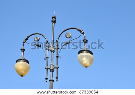 Street lamp with the blue sky as a backdrop. - stock photo