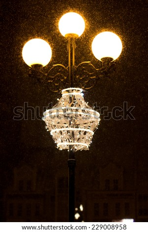 Street lamps in the night in winter - stock photo