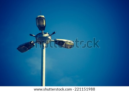 street lamps on blue sky