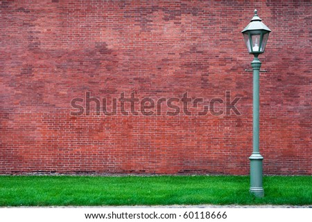 street lantern on brick wall background - stock photo