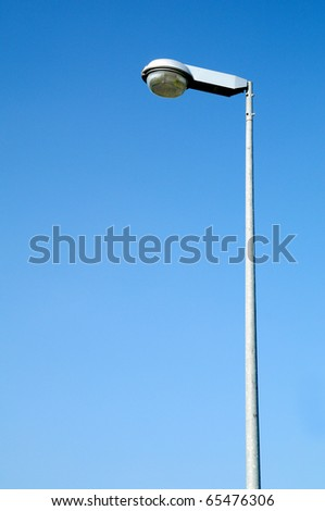 street light against a blue sky background - stock photo