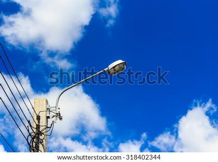 Street light against sky background - stock photo