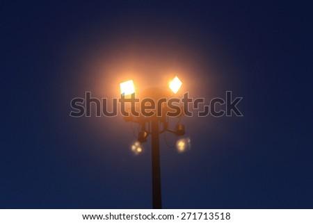 street light at night against a dark sky - stock photo
