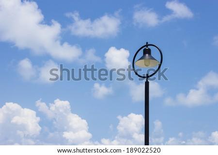 Street light lamp against blue sky. - stock photo
