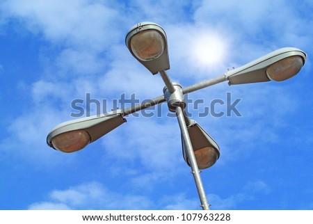 Street light on a blue sky background - stock photo