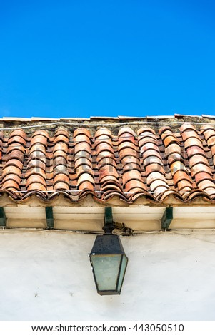 Street light on an old colonial building in Villa de Leyva, Colombia - stock photo