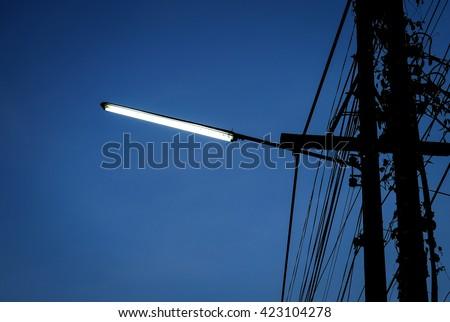 street light on blue sky background. - stock photo