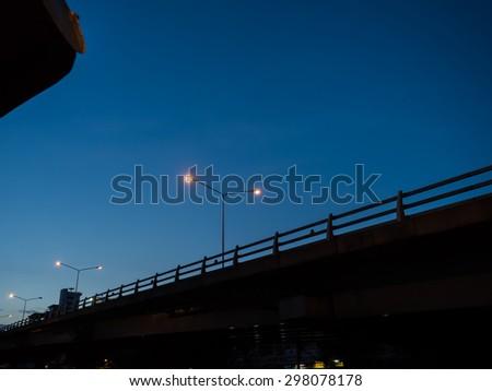street light on night blue sky - stock photo