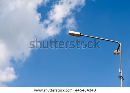 Street Light Pole Against Blue Sky - stock photo