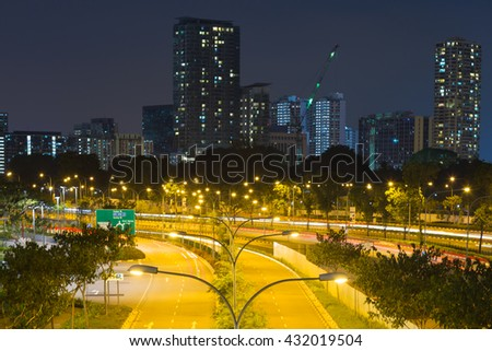 street light poles. Buildings and skyscrapers in Singapore. - stock photo