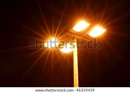 Street light showing rays of light extending outward - stock photo