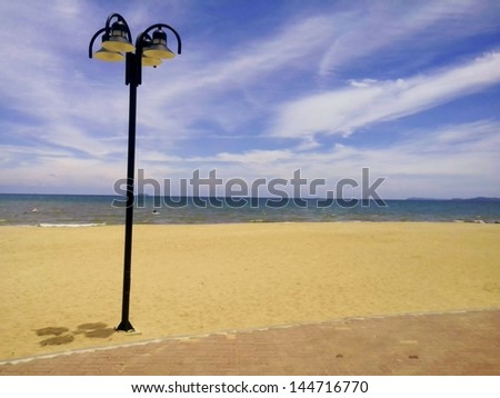 Street lighting on the beach with the blue sky