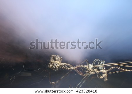 Street lights in speeding car, light motion with slow speed shutter. - stock photo