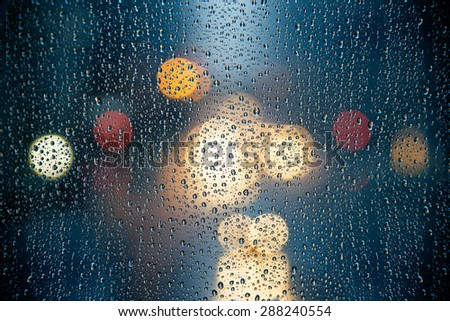 Street Lights Outside the Rainy Window - stock photo
