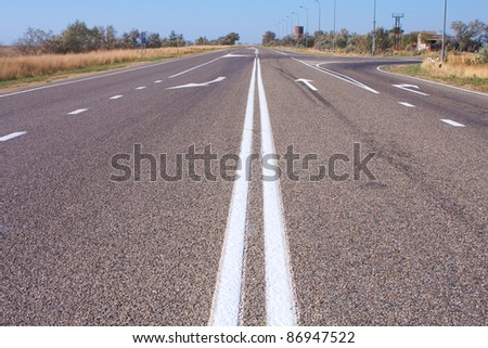 street lines and arrow direction on the road - stock photo