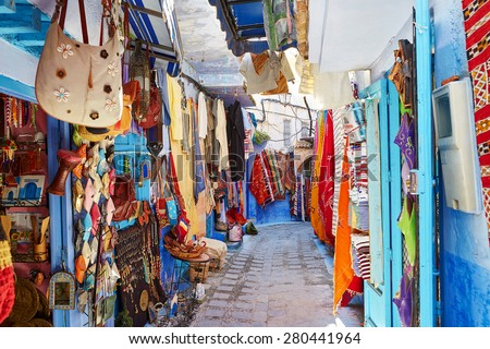 Street market in Chefchaouen, Morocco, small town in northwest Morocco known for its blue buildings - stock photo
