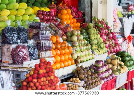 Street market with different exotic fruits. Vietnam, Asia - stock photo