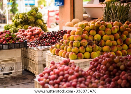 Street market with fruits and vegetables.