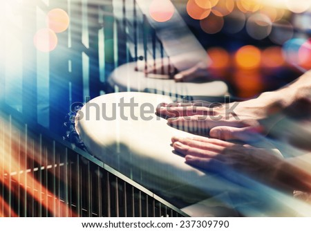 Street music background. Hands on percussion, abstract urban details and lights - stock photo