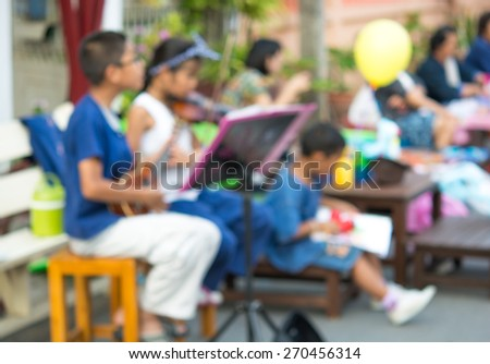 Street musicians playing on Market in Thailand , Blur style picture - stock photo