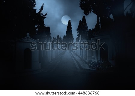 Street of an old European cemetery in a full moon night