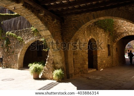 Street of Arch and lâ??Oli square of the village of Monells, Baix Emporda, Girona province, Catalonia,Spain