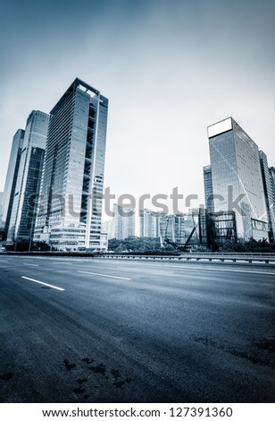 street of city at shenzheng china. blue toned image. - stock photo