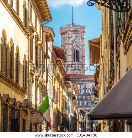 Street of Florence with the tower of  Santa Maria Del Fiore in the back (Tuscany, Italy)