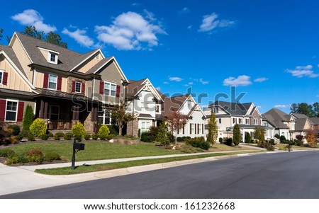 Street of large suburban homes - stock photo