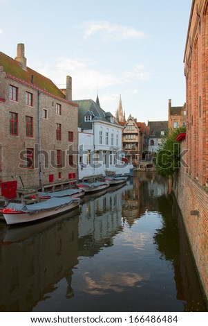 street of old Bruges with canal, Belgium