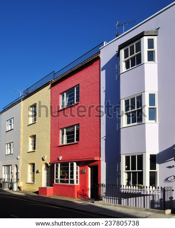 Street of painted terraced houses in the Chelsea district of London, UK.. - stock photo