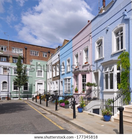 Street of small eighteenth century Georgian period terraced houses in London, UK. - stock photo
