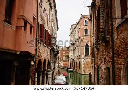 Street of the city of Venice. houses and water.