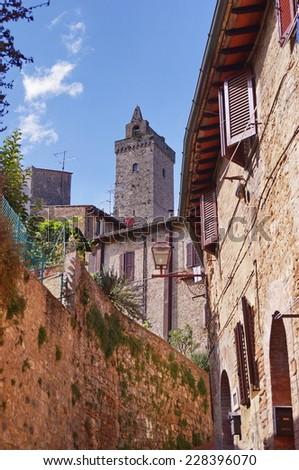 Street of the historical village of San Gimignano, Tuscany, Italy - stock photo