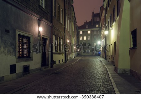 Street of the old city in Warsaw at night