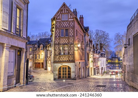 Street, paved with stone blocks and half-timbered house in the center of Orleans, France