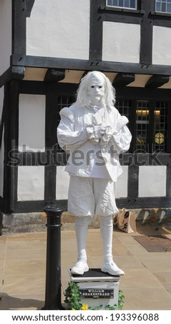 Street performer, acting as William Shakespeare's ghost close by to his birthplace on Henley Street in Stratford upon Avon. - stock photo