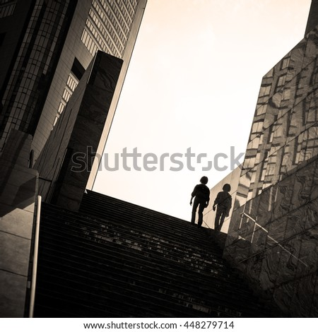 Street photography in Tokyo, detail of the architecture and silhouettes figure in the Ginza district. Negative space area for text. - stock photo
