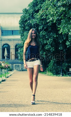 street portrait of a beautiful young woman - stock photo