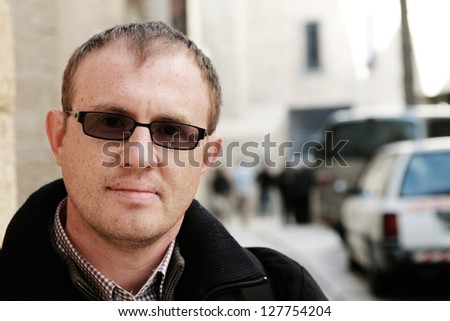 street portrait of 35 years old man - stock photo