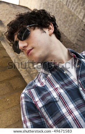 Street portrait of young man wearing sun glasses