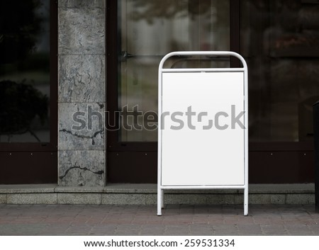 Street poster - clamshell in white painted steel frame. Clipping path. Shallow depth of field. - stock photo