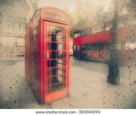 Street scene in London with iconic red phone booth and double decker bus.  This image has a rainy texture overlay.  - stock photo