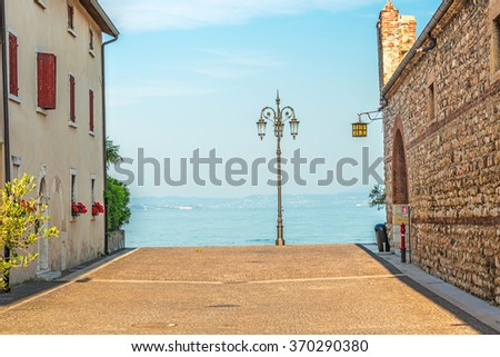 Street Scene of a Mediterranean town at the lake - stock photo
