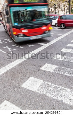 street scene with a bus in motion blur - stock photo