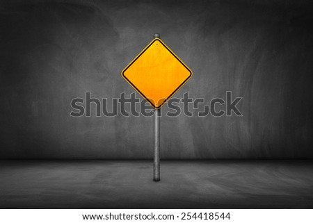 Street Sign: blank yellow road sign with street wall. - stock photo