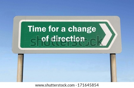 Street sign indicating the direction to 'Time for a change of direction' on blue sky background