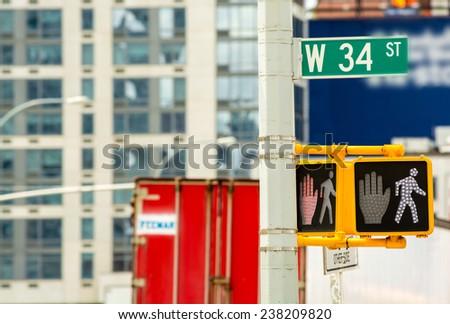 Street sign on the corner of 34st Street in Manhattan, New York City - stock photo